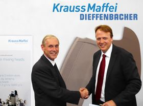 Dr Günter Kuhn (left), Managing Director and CTO of the Dieffenbacher Group, and Frank Peters (right), member of the Board of Management of KraussMaffei, confirm their collaboration on high pressure RTM systems.