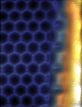 A scanning tunnelling microscope image of the bismuthene film. The honeycomb structure of the material (blue) is visible, analogous to graphene; a conducting edge channel (white) forms at the edge of the insulating film (on the right). Image: Felix Reis.
