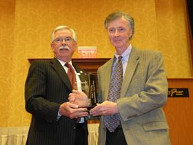 Bernie Haviland (right), owner of Haviland USA, accepts the August P. Munning Award.