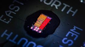 Prototype optoelectronic microprocessors that computes electronically but uses light to move information. Image courtesy of Glen Asakawa