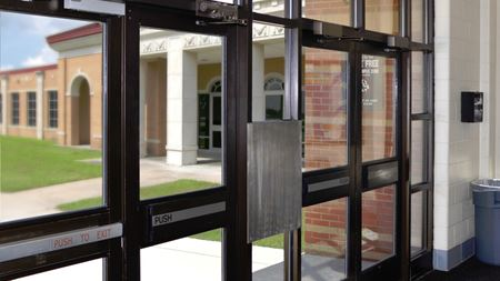 Composite sheet reinforces school entryway