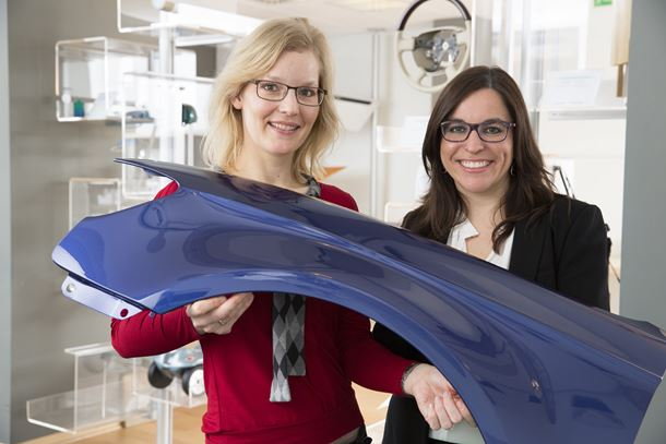 Dr. Gesa Behnken (left), global head of new technologies, and Dr. Berta Vega Sánchez, marketing manager in the coatings, adhesives, specialties business unit of Bayer MaterialScience, present a coated car body part.