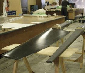 Manufacturing the twin carbon rudders. A rudder stock is seen on the right and a full blade to the left. (Picture courtesy of Killian Bushe and Andrew Lowe.)