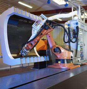 Multi-axis articulating robotic machines like this, currently being developed for manufacturing operations, could be adapted for automated repair use. (Picture courtesy of Coriolis Composites.)