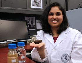 Pavani Cherukupally with the sponge and 'before and after' water samples in her lab at the University of Toronto. Photo: Imperial College.