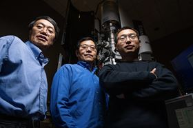 (Left to right) PNNL scientists Chongmin Wang, Wu Xu and Yang He with the specially modified environmental transmission electron microscope they used to capture images and video of growing whiskers inside a lithium battery. Photo: Andrea Starr/PNNL.