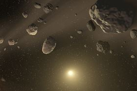 This shows an artist's rendering of an asteroid belt orbiting a star, which could house complex hydrocarbons such as pyrene. Image: NASA/JPL-Caltech.
