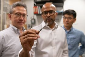 (From left to right) Seung Soon Jang, Faisal Alamgir and Ji Il Choi from Georgia Tech examine a piece of platinum-graphene catalyst. Photo: Allison Carter.