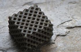 This photo shows an example of the hierarchical metallic metamaterials produced by a novel 3D printing process; these metamaterials possess multi-layered, fractal-like 3D architectures that incorporate nanoscale features. Photo: Jim Stroup/Virginia Tech.