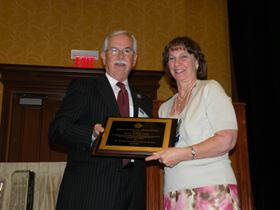 Evelyn Hallberg, Executive Director, Chicago Metal Finishers Institute, accepting an Award of Special Recognition.