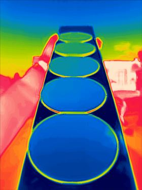 Silicon wafers coated with the gradient ENZ materials viewed through a thermal imaging camera. Image: Raman Laboratory/UCLA.