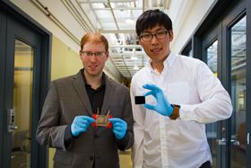 Jeonyoon Lee (right) holds an aligned carbon nanotube array, and Itai Y Stein (left) holds the resulting aligned carbon nanotube film microheater.