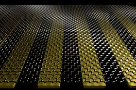 Researchers at the University of Minnesota combined graphene with nano-sized metal ribbons of gold to create an ultrasensitive biosensor that could help detect a variety of diseases in humans and animals. Image: Oh Group, University of Minnesota.