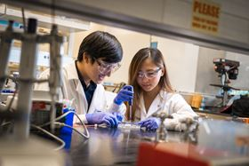 Bioengineering graduate student Michael Hu and undergraduate student Xin Yi (Linda) Lei construct a vascularized gut model using their team's new 3D bioprinting technique. Photo: UC San Diego Jacobs School of Engineering.