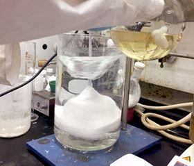 A researcher at Berkeley Lab demonstrates the bulk synthesis of a polysulfate via the SuFEx reaction. Photo: Berkeley Lab.