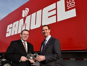 Samuel Manufacturing president Colin Osborne (pictured right) and Peter Adams, president of Burloak Technologies, holding a component produced with Burloak AM capabilities.