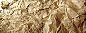 Crumpled paper shows fractal patterns of creases that look the same at different scales (right image shows the right corner of the left image at higher magnification).  Caltech scientists have now discovered that the atoms in glasses also display fractal patterns at small scales. Image: David Chen/Greer Laboratory/Caltech.