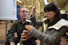 Lou Madsen (left) and Ying Wang (right) from Virginia Tech were part of an international team that discovered a polymer called PBDT has a double-helix structure. Photo: Virginia Tech.
