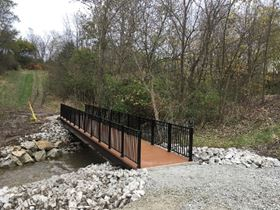 Composite Advantage has developed a new line of standard size fiber reinforced polymer (FRP) trail bridges.