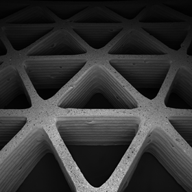 Image of a 3D printed ceramic architecture composed of porous foam struts arrayed in a triangular honeycomb geometry (credit: Joseph Muth, James Weaver and Jennifer Lewis, Harvard University)