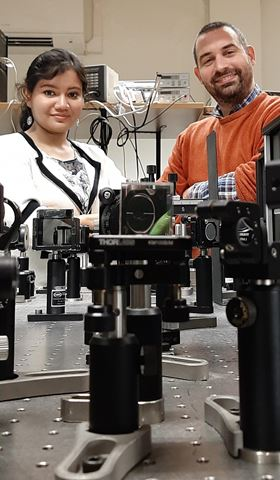 Chandrima Banerjee (left) and Jean Besbas (right) with the instrumentation they used to discover that the MRG alloy can act as a super-fast magnetic switch. Photo: CRANN, and Trinity College Dublin.