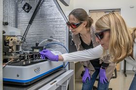 Berkeley Lab researchers Francesca Toma (left) and Johanna Eichhorn (right) used a photoconductive atomic force microscope to better understand materials for artificial photosynthesis. Photo: Marilyn Chung/Berkeley Lab.