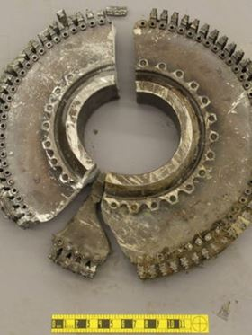 A cracked metal disk from an airline engine. The crack was caused by the type of metal fatigue that the new method would be able to predict long before a crack ever appears. Photo: NTSB.