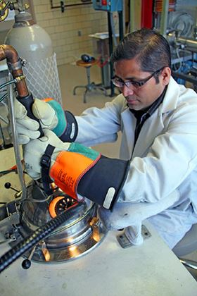Scientist Arjun Pathak arc melts material in preparation for producing a new type of magnet.