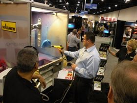 Spray equipment demonstrations at the Wagner Industrial Systems booth.
