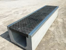 Fibrelite and Trenwa's partnership product: heavy duty precast concrete trenches topped with light strong composite covers.