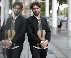 Luca Alessandrini and his composite violin. Photo: Imperial College London.