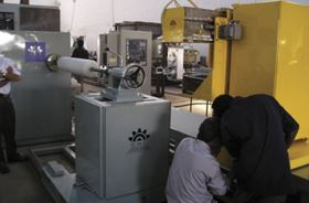 CNC Technics has installed a six-axis winder such as this one at the IIT in India for hands-on demonstration of filament winding.