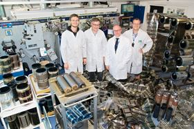 Frederik C. Krebs (second from right) with his large-scale organic solar cell fabrication team (Markus Hösel, Mikkel Jørgensen, and Roar R. Søndergaard, from left to right) in one of the R2R fabrication laboratories.