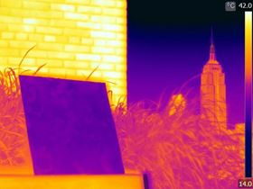 This infra-red image shows how the porous polymer PDRC coating can reflect sunlight and emit heat to attain significantly cooler temperatures than typical building materials or even the ambient air. Image: Jyotirmoy Mandal/Columbia Engineering.