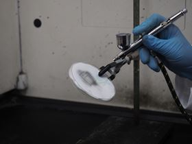 Spray-painting an MXene antenna. Photo: Drexel University – Kanit Hantanasirisakul.