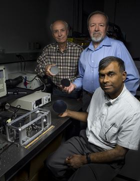 John Kolasinski (left), Ted Kostiuk (center) and Tilak Hewagama (right) hold mirrors made of carbon nanotubes embedded in an epoxy resin. Photo: NASA/W. Hrybyk.