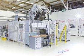 Henkel's HP-RTM equipment, located at Henkel's Composite Lab in Heidelberg (Germany), has resin injection units for polyurethanes and epoxies coupled to a 380-tonne press. (Photo courtesy Henkel.)