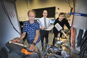 Brookhaven Lab scientists Percy Zahl (left), Ivan Bozovic (center) and Ilya Drozdov (right) at the Center for Functional Nanomaterials. They are using a custom-built scanning tunneling microscope to image the surface structure of 2D atom-thin sheets of boron on copper. Image: Brookhaven National Laboratory.
