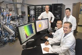 Brookhaven Lab scientists (left to right) Ivan Bozovic, Xi He, Jie Wu and Anthony Bollinger with the atomic layer-by-layer molecular beam epitaxy system used to synthesize the superconducting cuprate samples. Photo: Brookhaven National Laboratory.
