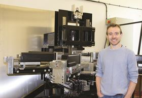 PhD student Chris Cleaver with ring rolling machine, The Lord of the Rings.