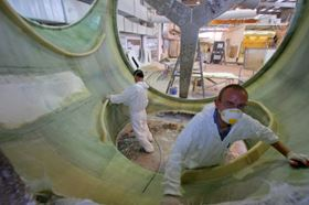 Markos workers finishing the interior of a 9 m long nacelle.