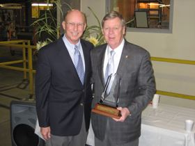Jim Jones (left), president of Dixie Industrial Finishing, presents the NAM Award to Sen. Johnny Isakson (R-Ga.).