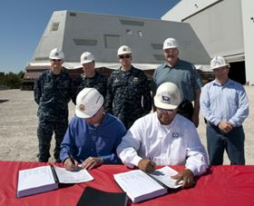 The signing of the documents signifying the delivery of the Zumwalt (DDG 1000) deckhouse (seen in background) to the US Navy.