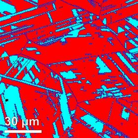 This image, which was produced by electron backscatter diffraction, shows the novel alloy made from iron, manganese, cobalt and chrome, with the blue and red regions representing the different crystal structures. Image: Nature 2016/MPI f. Eisenforschung.