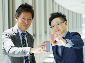 Chihaya Adachi (left) and Ryota Kabe (right) of Kyushu University's Center for Organic Photonics and Electronics Research (OPERA) have developed the world's first glow-in-the-dark materials based on organic molecules. Image: Center for Organic Photonics and Electronics Research.