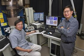 Brookhaven physicist Qiang Li (right) and materials scientist Lijun Wu (left) in an electron microscopy lab at Brookhaven National Laboratory. Photo: Brookhaven National Laboratory.