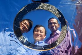 Three Stanford engineers have developed a novel transparent material that improves the performance of solar cells by shunting away heat while still letting through visible light. From left to right: Stanford doctoral candidate Linxiao Zhu, electrical engineering professor Shanhui Fan, and research associate Aaswath P. Raman. Image: Stanford Engineering.