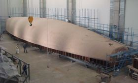 RMK Marine is manufacturing 100 ft (30 m) and 125 ft (38 m) superyachts for Oyster Marine Ltd. RMK has built a new composites facility at its shipyard in Tuzla, featuring a 72 m hall and a 40 m long oven. The Oyster vessels will be produced using the vacuum infusion process and the first is scheduled for launch early in 2010. The picture shows the hull plug for the 125 model.