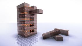 Much like pulling blocks from a tower in a Jenga game, scientists used chemistry to neatly remove a layer of oxygen atoms from a perovskite material. This flipped the material into a new atomic structure – a nickelate – that can conduct electricity with 100% efficiency. Image: Greg Stewart/SLAC National Accelerator Laboratory.