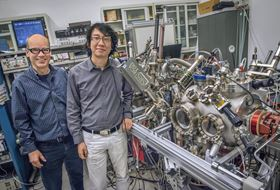 Andreas Schmid (left) and Gong Chen (right) with the SPLEEM instrument at Berkeley Lab. Photo: Roy Kaltschmidt/Berkeley Lab.